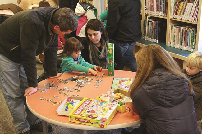 kids playing games at manchester community library